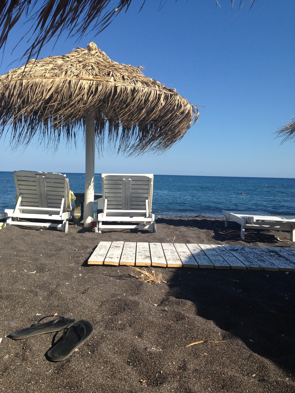 Rent a chair and umbrella and enjoy the black sand beaches.