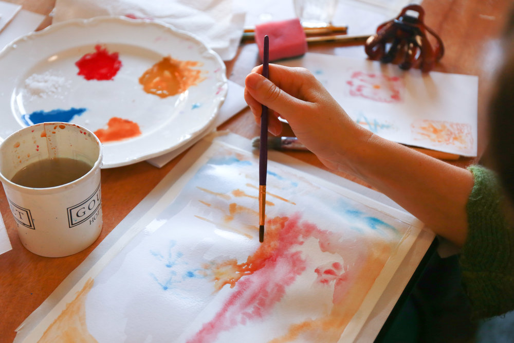 A student painting at one of my Mindful and Intuitive watercolour workshops. Photo by Julian Barford Photography.