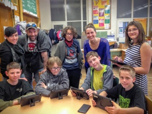 Viscount Montgomery teacher Sarah Weston (in blue) with Code Club students and parents at the school's recent open house.