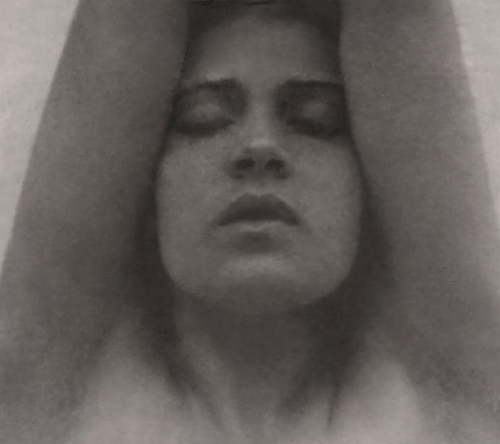 Tina_Modotti_with_her_arms_raised_-_Edward_Weston_restoration.jpg