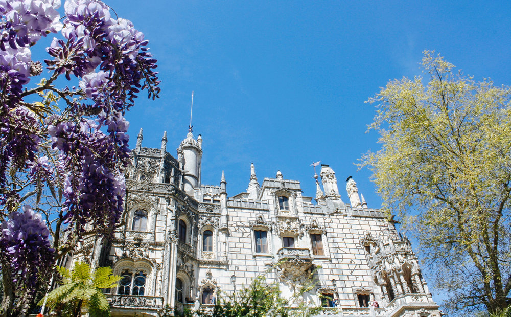 The  Pena Palace  is a wonderful Romanticist castle that sits atop a hill in the Sintra Mountains, offering beautiful views from anywhere you stand.