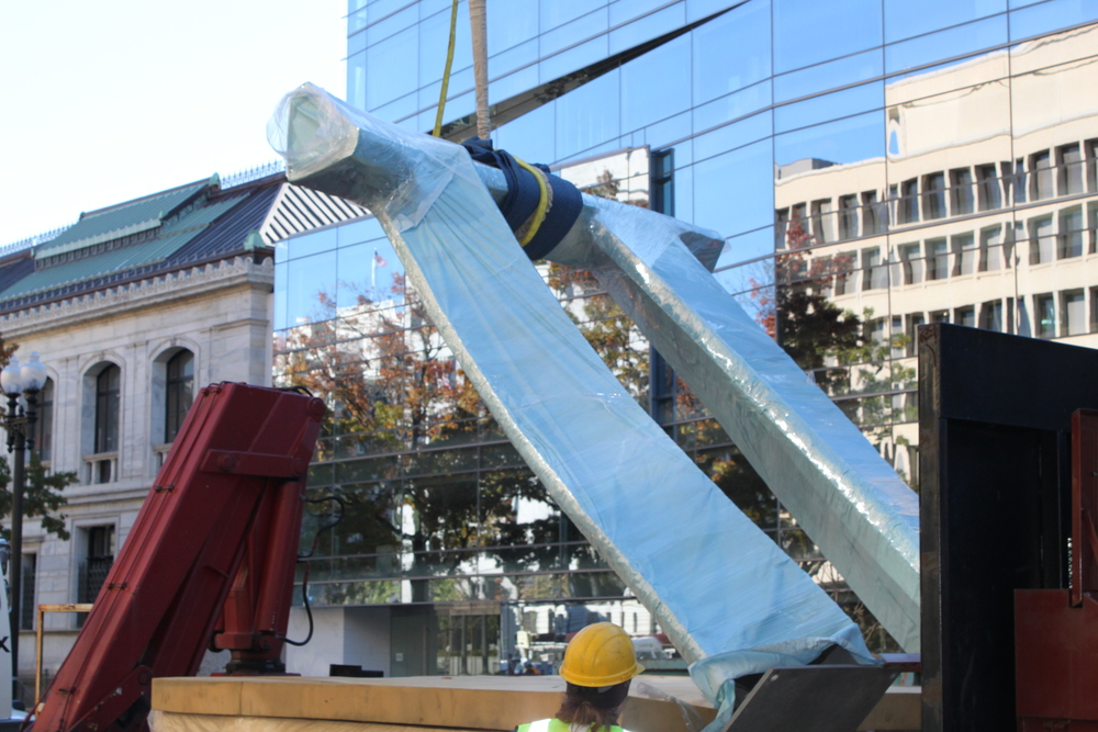 Arch in Flight is lifted from truck to air with a powerful crane.