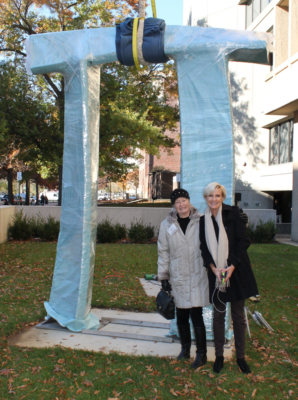 Emilie and Mika Brzezinski pose in front of Arch in Flight before it is unwrapped.