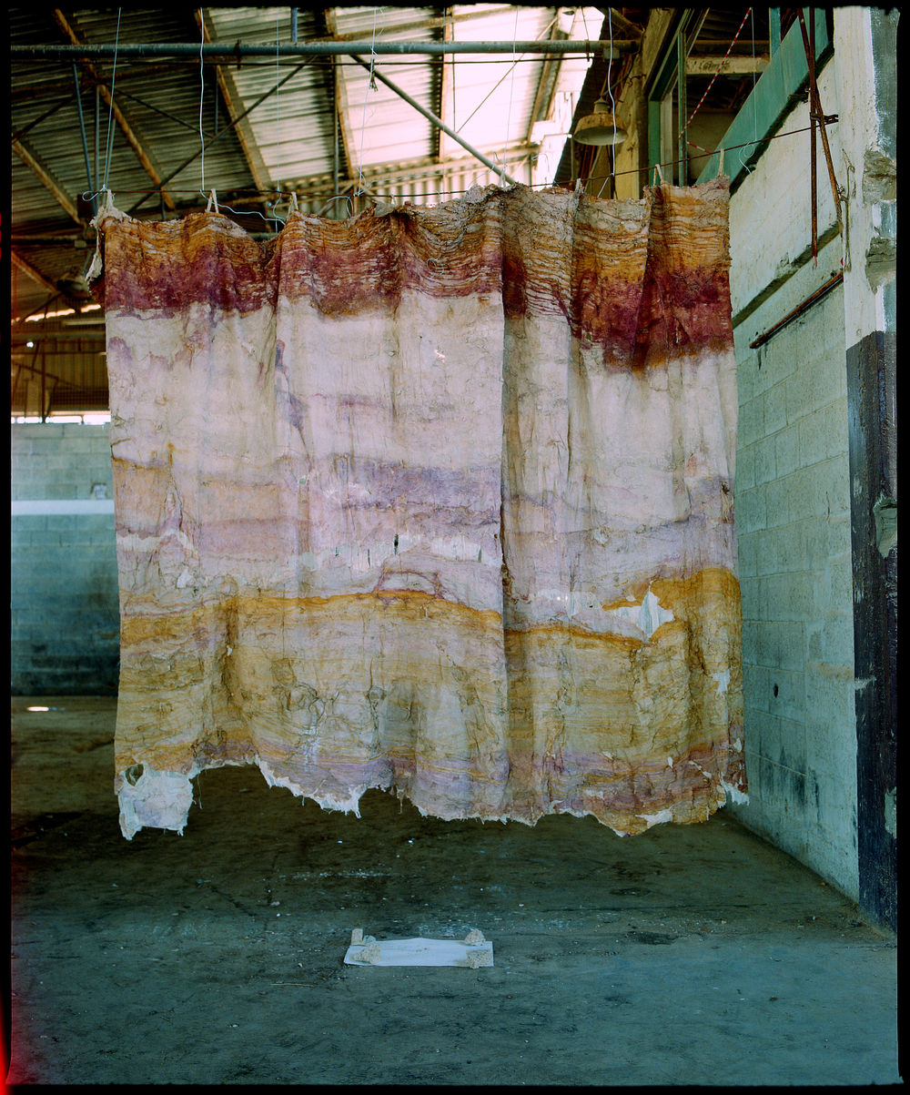 "Desert Curtain, shown at the ""Construction in Process V: Co-Existence,"" symposium, Negev, Israel, 1995. Burlap and glue, 7' x 9'6""."