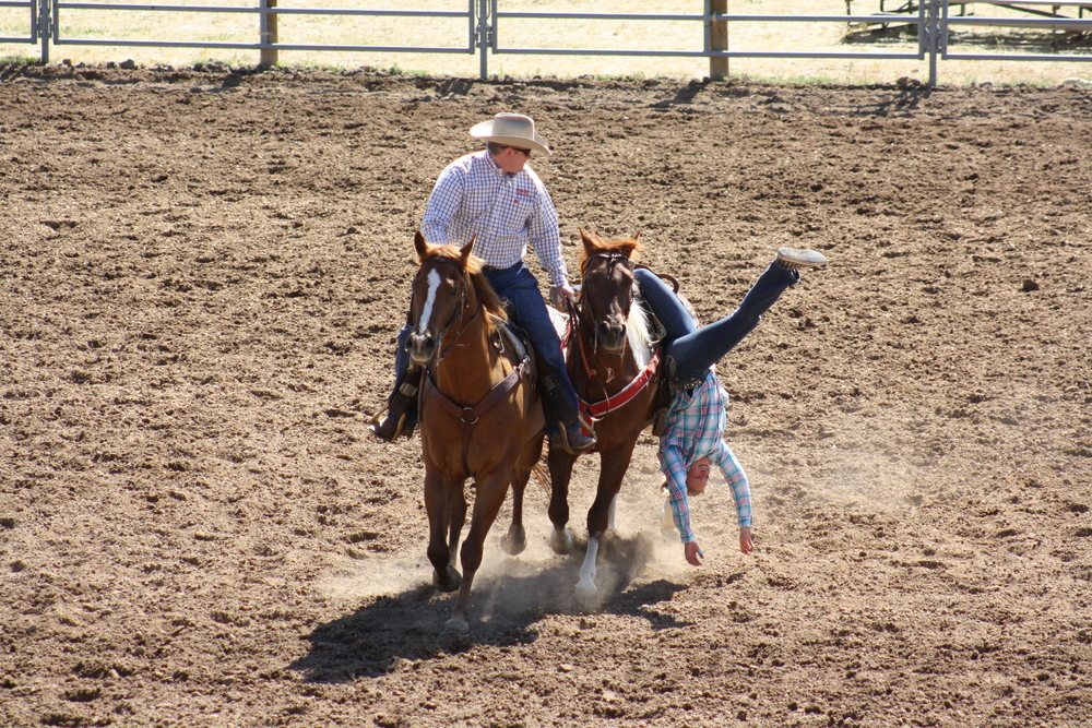 One of the Flat Tops RBC trick riding students doing a Cossack Drag on the rodeo on the last day of the camp.  I'm very thankful for good horses that I can trust.