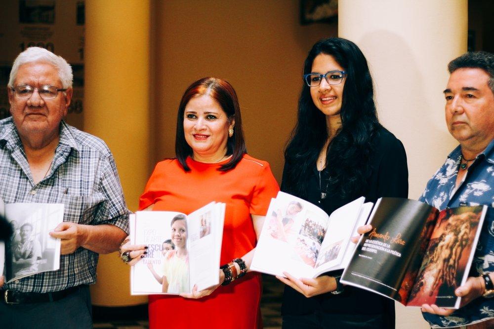 At CAC-UNAH Receiving the Catalog