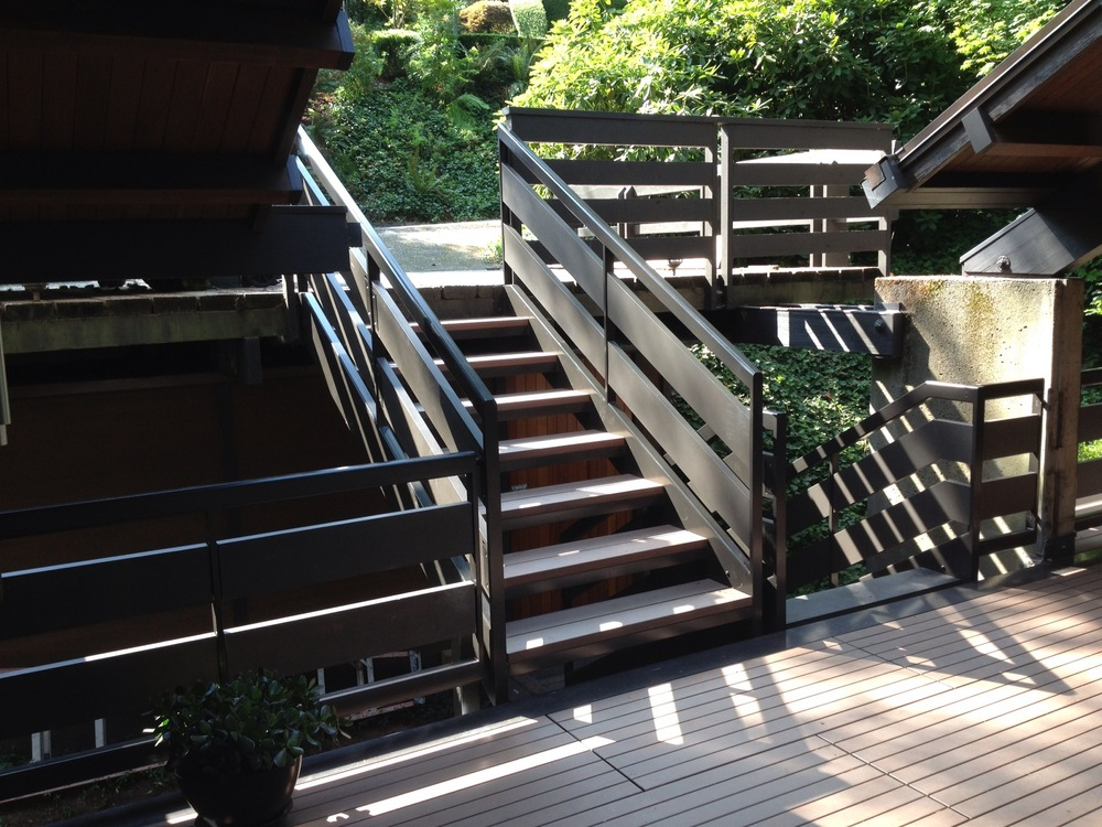 Staircase and railing out of painted steel. Railing continued around the entire deck with wood infill.  Designed by Paul McKean Architects
