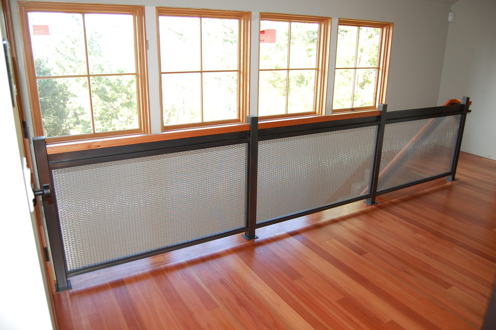 Blackened Steel Railing with Stainless Steel woven wire mesh  Designed by Formed Objects
