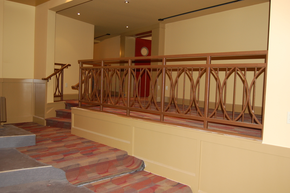 Painted steel railing for a home movie theater.  Designed by Group Jake Collaborative