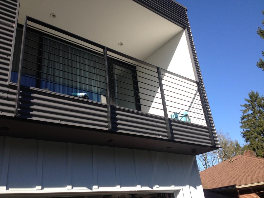 Painted steel railing with round rod infill  Designed by Paul McKean Architecure