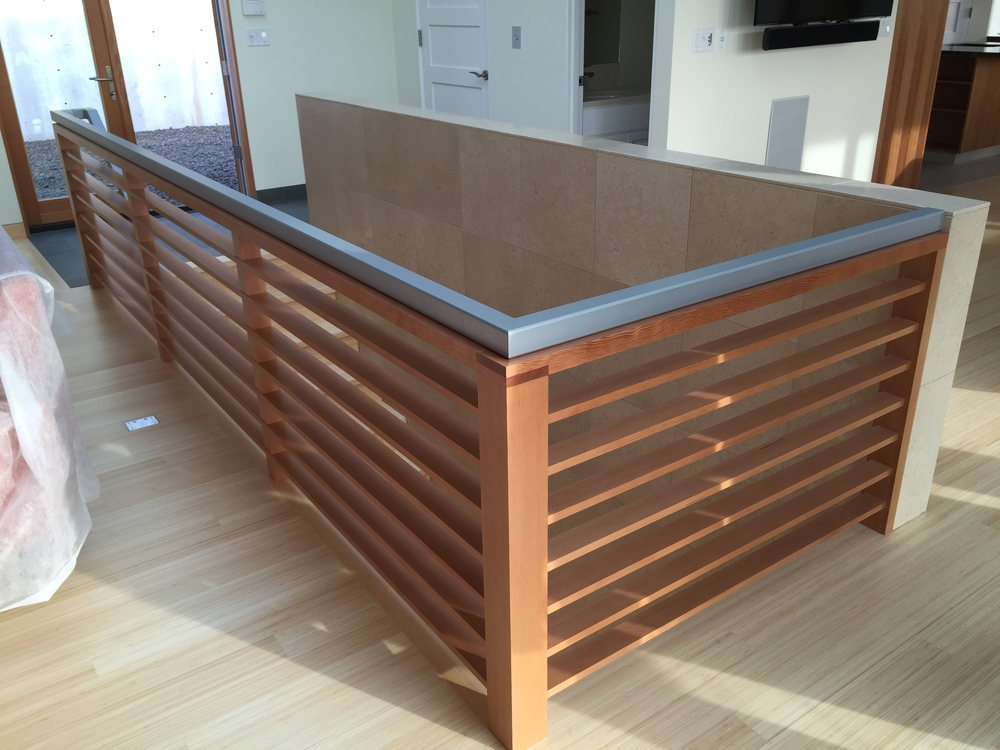 Steel top cap. Wood done by Green Gables Construction.  Designed by Pete Retondo Architecture