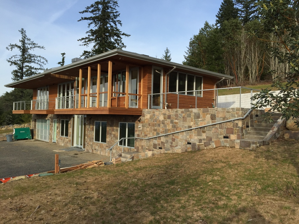 3 decks and a stone wall with steel railing with stainless cable infill.  Designed by Pete Retondo Architecture