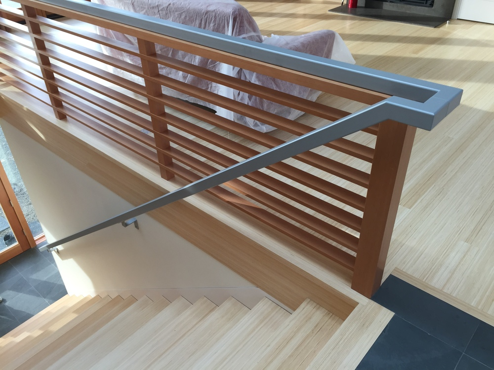 Steel grab rail. Wood done by Green Gables Construction  Designed by Pete Retondo Architecture
