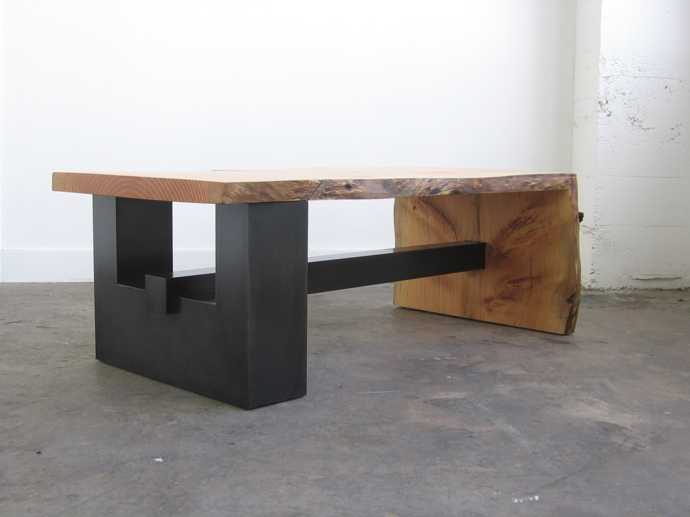 Blackened Steel Base with a live edge top that was taken from the residence property.  Designed by Formed Objects