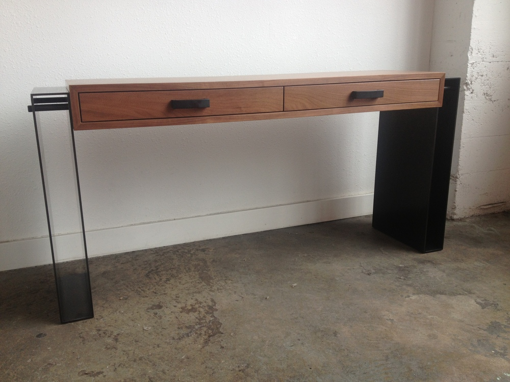 Hot Rolled Steel legs that's bolted into a Walnut Cabinet.  Designed by Hensel Design Studios