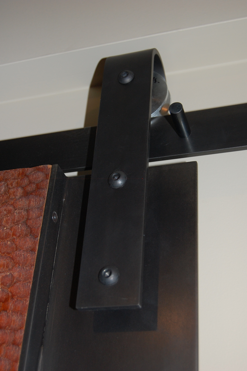 Blackened steel door wrap with rolling track  Designed by Eggleston Farkas Architecture