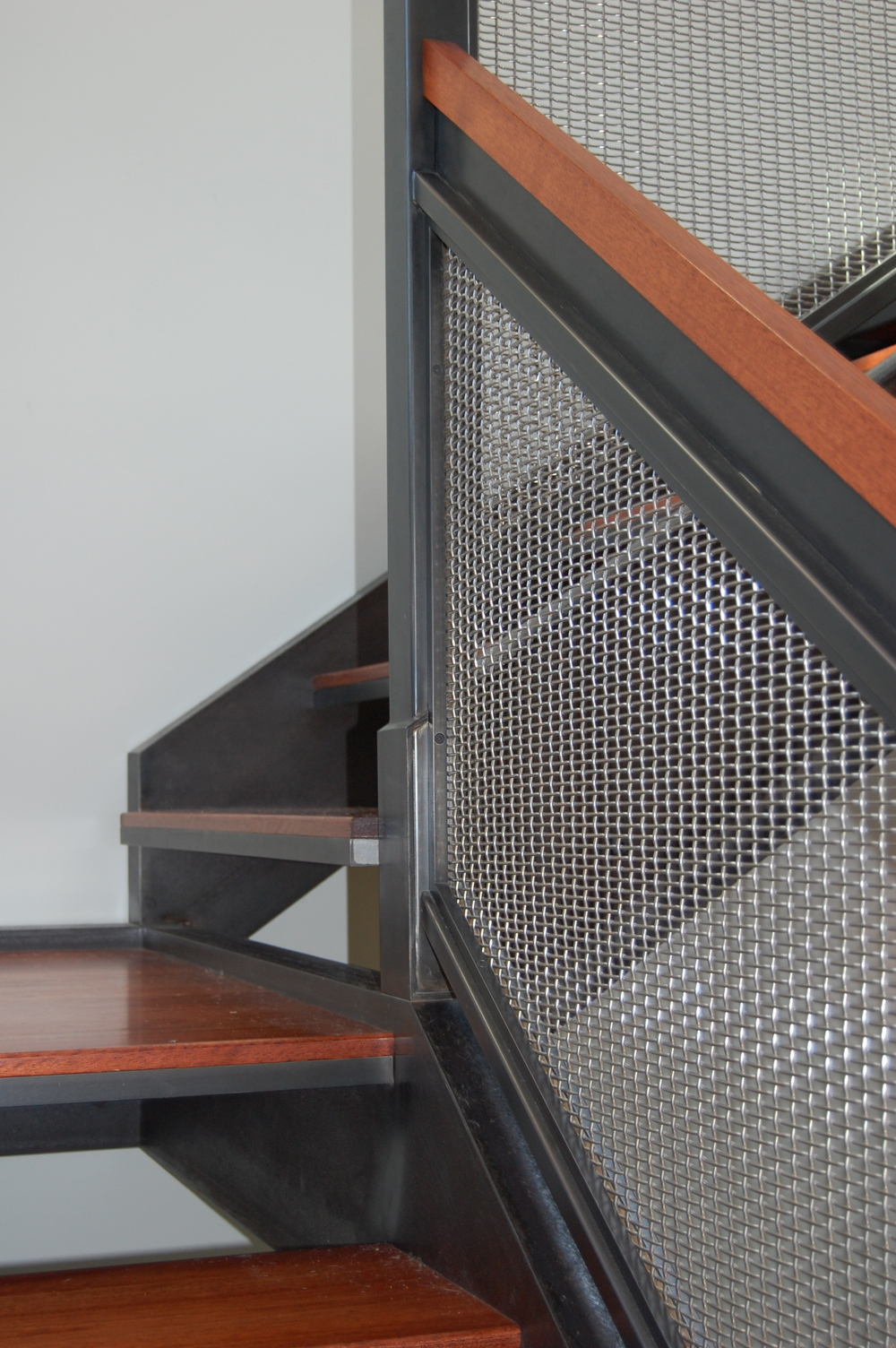 Blackened steel railing with stainless woven wire mesh.  Designed by Formed Objects