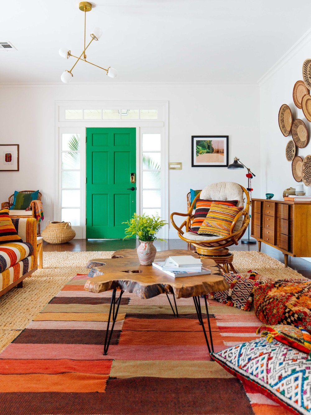 Its super eclectic with a nice mix of different textiles but mostly brown and tan shades the charlie rug is such a great addition to that space