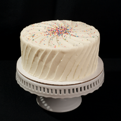 "Vanilla Explosion Two layer vanilla cake with vanilla butter cream frosting. 6"" (serves 8): $26 