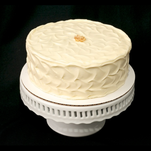 "Ginger Molasses   Two layers of ginger molasses spice cake filled and frosted with cream cheese frosting.   6"" (serves 8): $28  