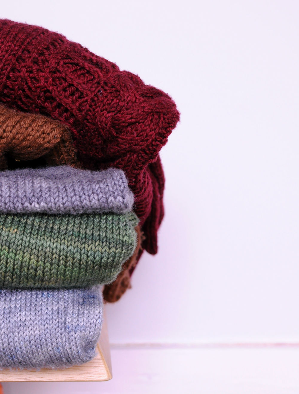 A small and very loved pile of knitwear