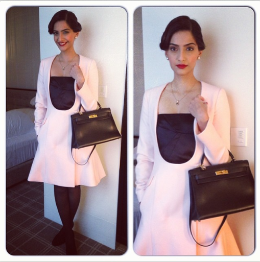 Sonam Kapoor in a Dior dress, Christian Louboutin shoes with an Hermes Kelly bag