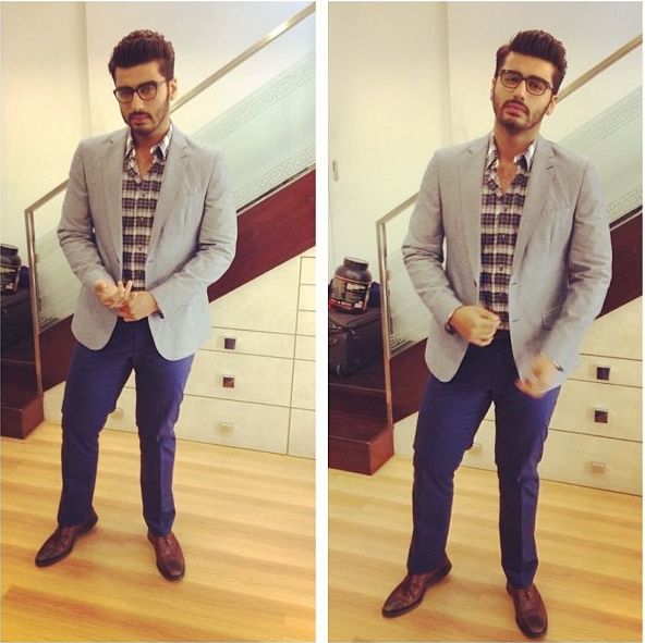 Arjun Kapoor in Burberry trousers, shirt & Jacket from The Collective and Emanuel Strazzi spectacles