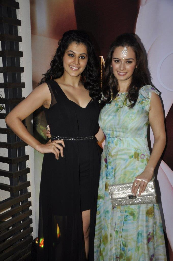 Tapsee Pannu and Evelyn Sharma carrying Jimmy Choo clutch