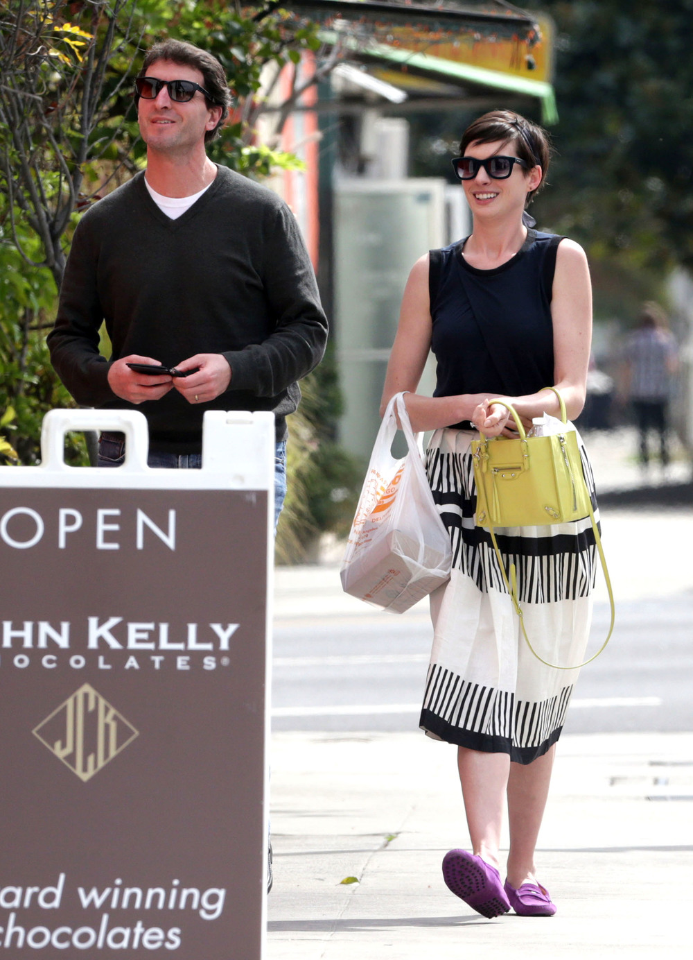 Anne Hathaway in Balenciaga and Tod's