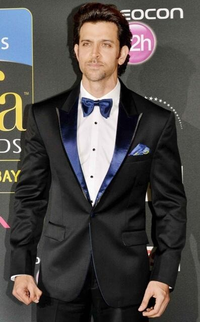 Hrithik Roshan in a black tuxedo with blue lapels and a blue bow-tie