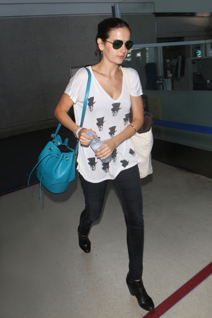 Camilla Belle carried a Gucci Pre Fall 2014  Bright Diamante teal leather bucket bag.  Image Courtesy: Gucci/Getty Images.