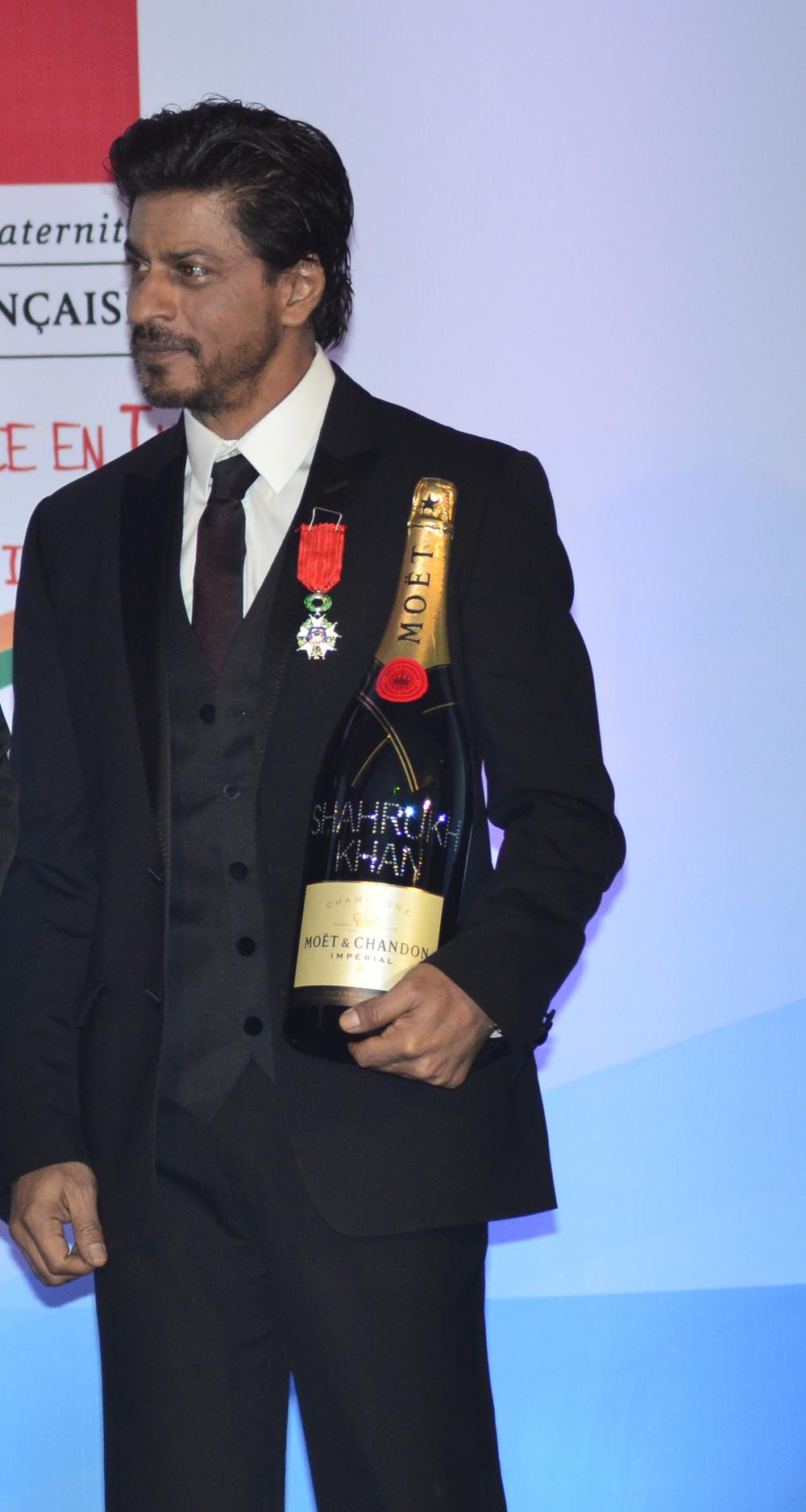 Shah Rukh Khan holding the Moet & Chandon customized Jeroboam.jpg