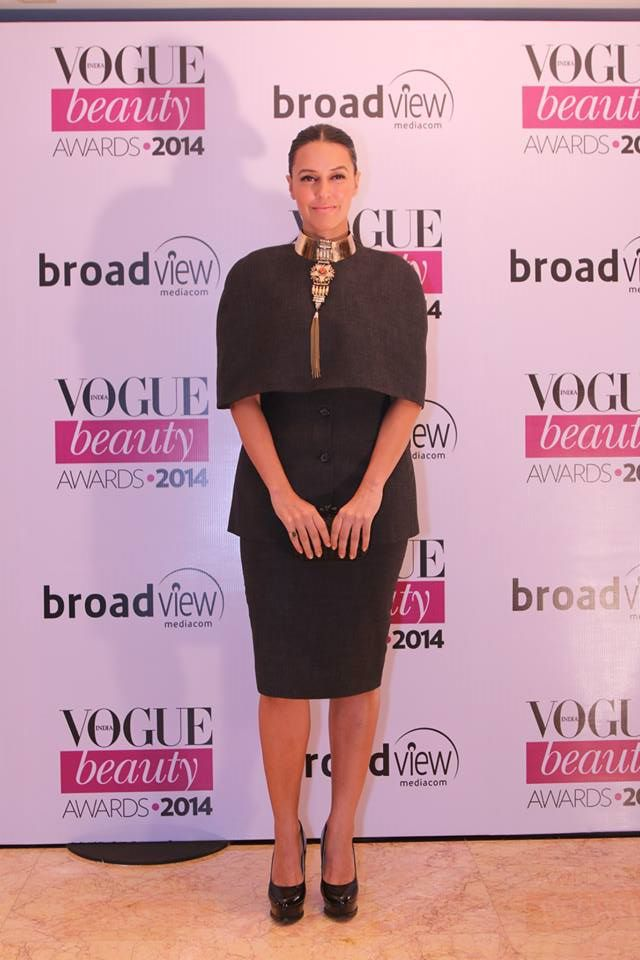 Neha Dhupia in Heumn, Outhouse jewellery and Bottega Veneta knot at the Vogue Beauty Awards 2014