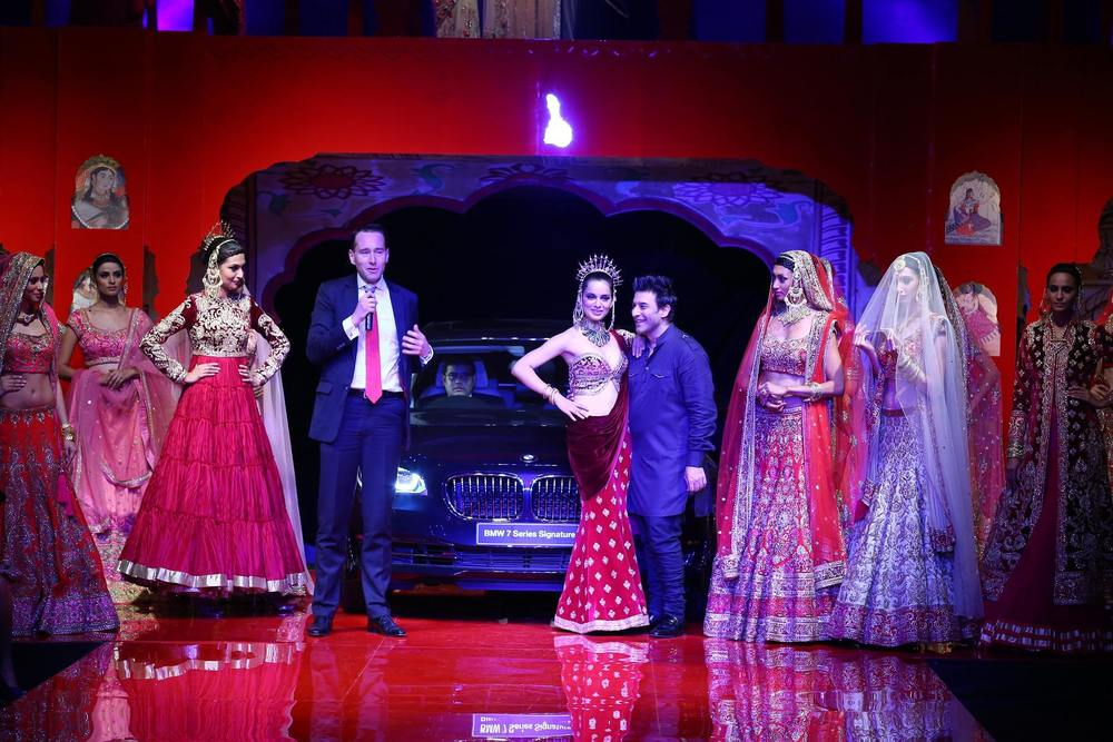 Frank Schloeder,Director Marketing BMW Group India, Kangana Ranaut and Suneet Varma at BMW India Bridal Fashion Week 2014 in association with AZVA at DLF Emporio.jpg