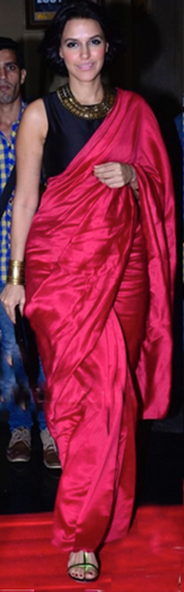 Neha Dhupia in a Payal Singhal saree, BCBG clutch and Jimmy Choo sandals.