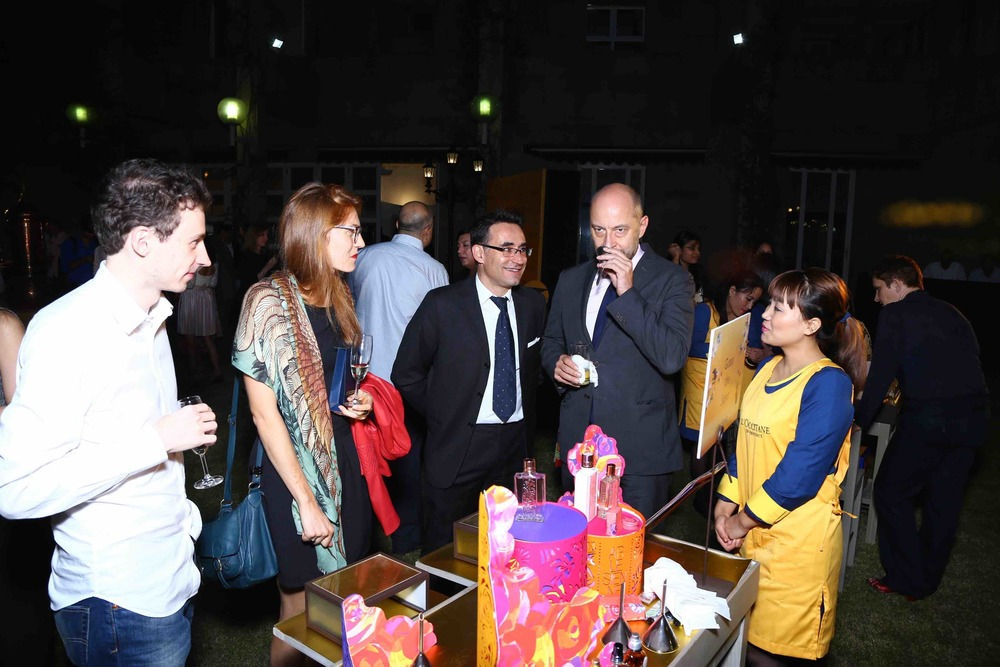 The French ambassador  Franc?o is Richier & L'OCCITANE's Country Head Gilles Moutounet with guests at the scent station