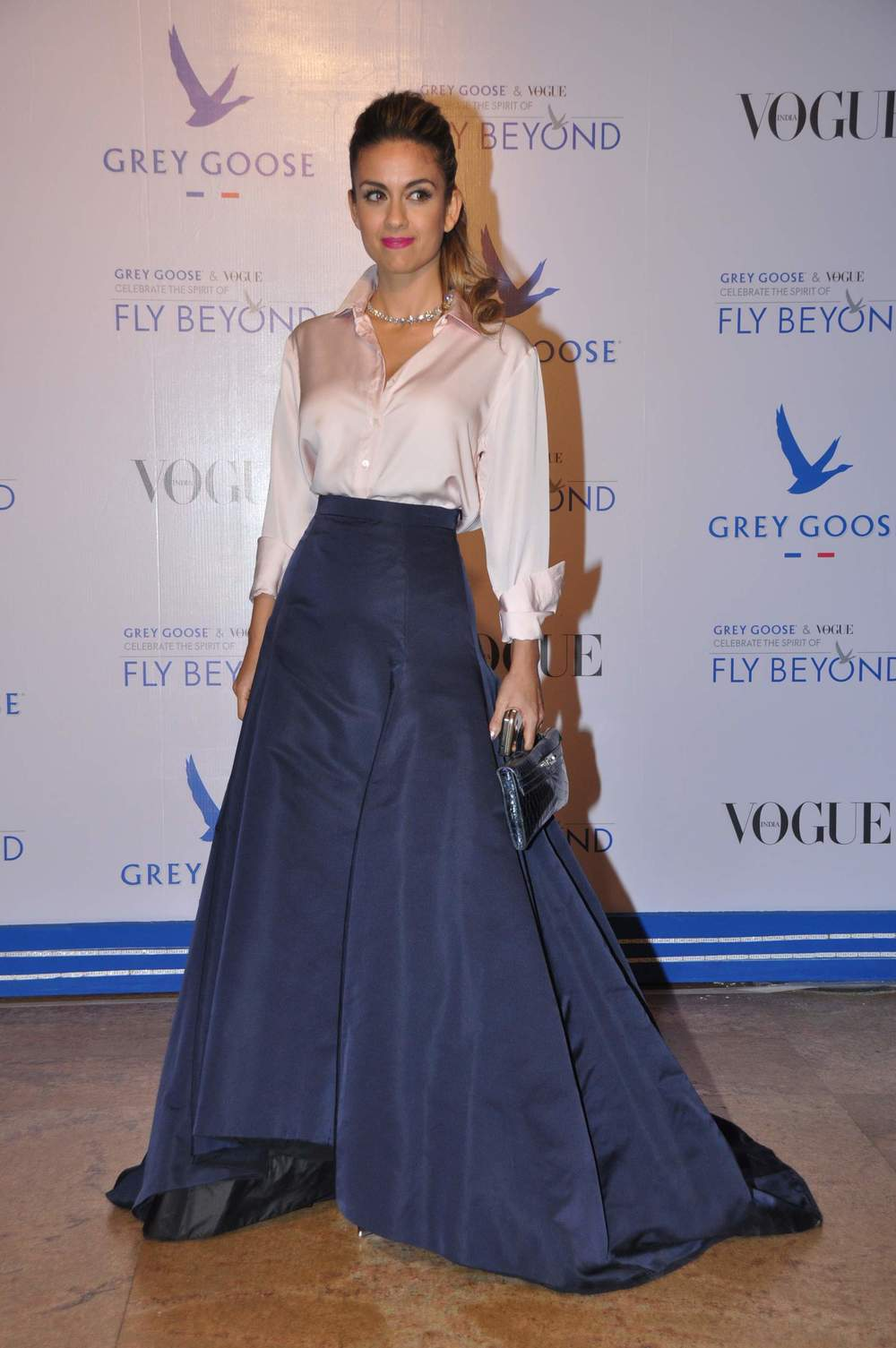 Natasha Poonawala carrying an Hermes Clutch