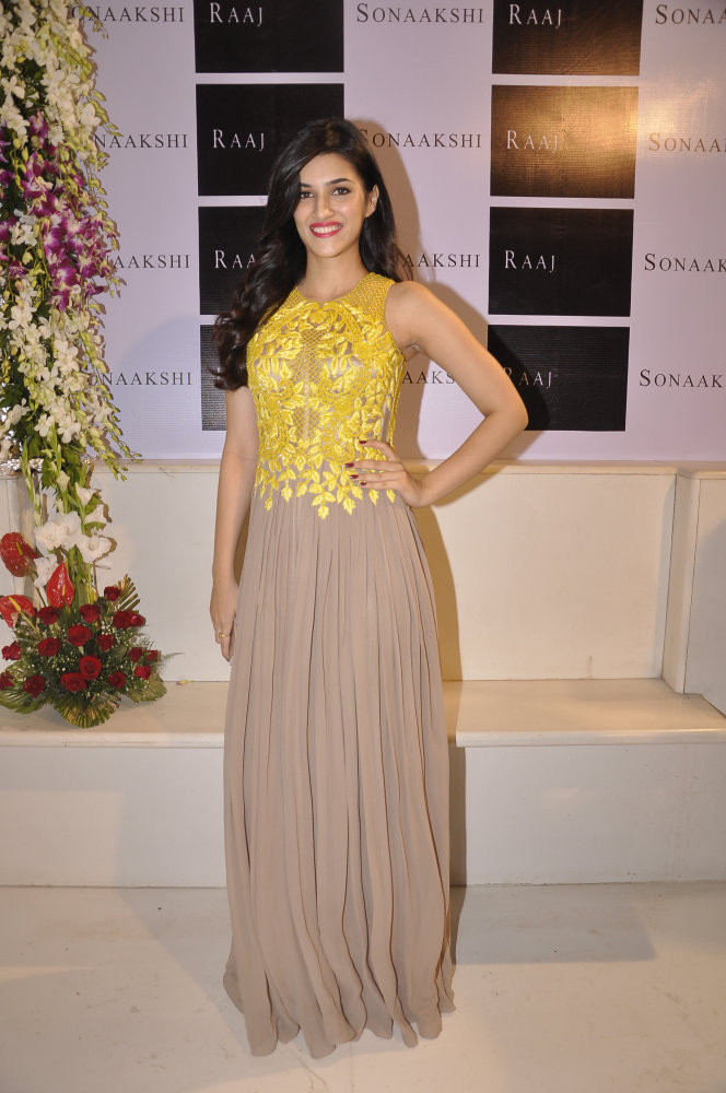 Kriti Sanon in an oyster palazzo jumpsuit with lemon yellow intricate bead-work detail.