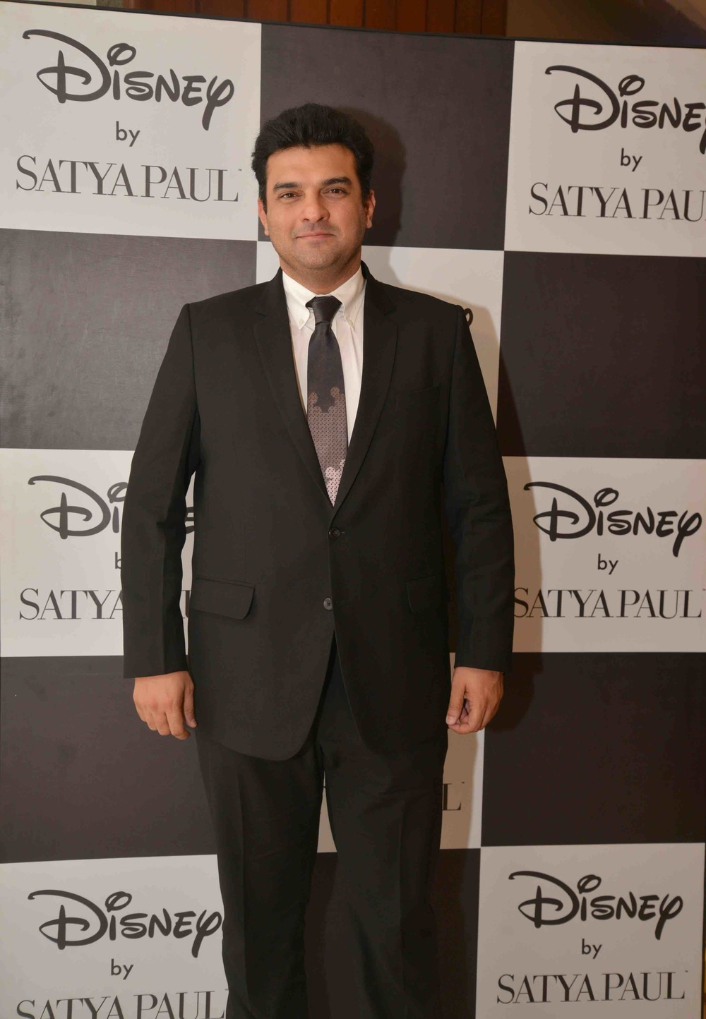 Siddharth Roy Kapur in a Disney Monopop By Satya Paul Tie