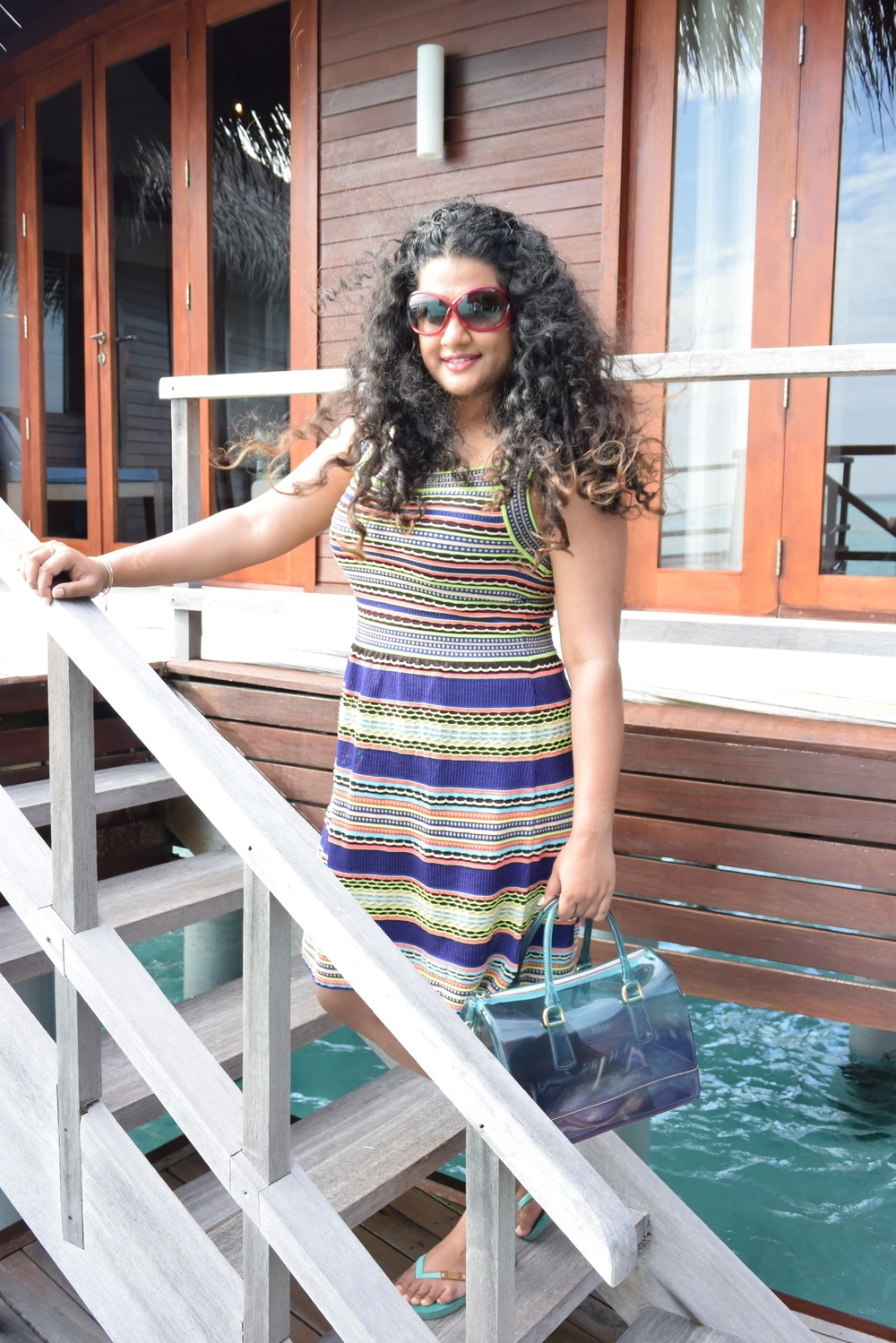Dress M Missoni, Flip-Flop Tory Burch, Bag Furla, Sunglasses Tom Ford, Hand-harness Isharya