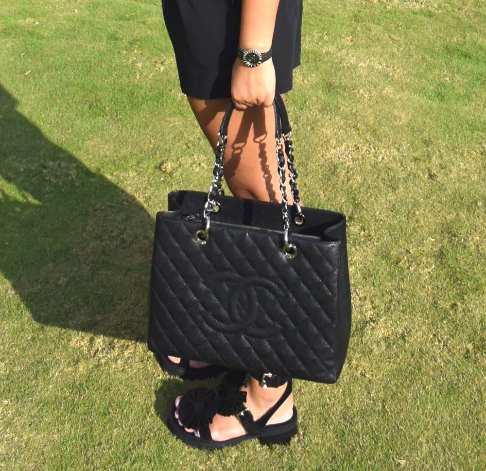 Shorts - Asos, T-shirt - Armani Exchange, Bag - Chanel, Sandals - Chloe for Opening Ceremony, Watch - Dior & Sunglasses - Chanel.