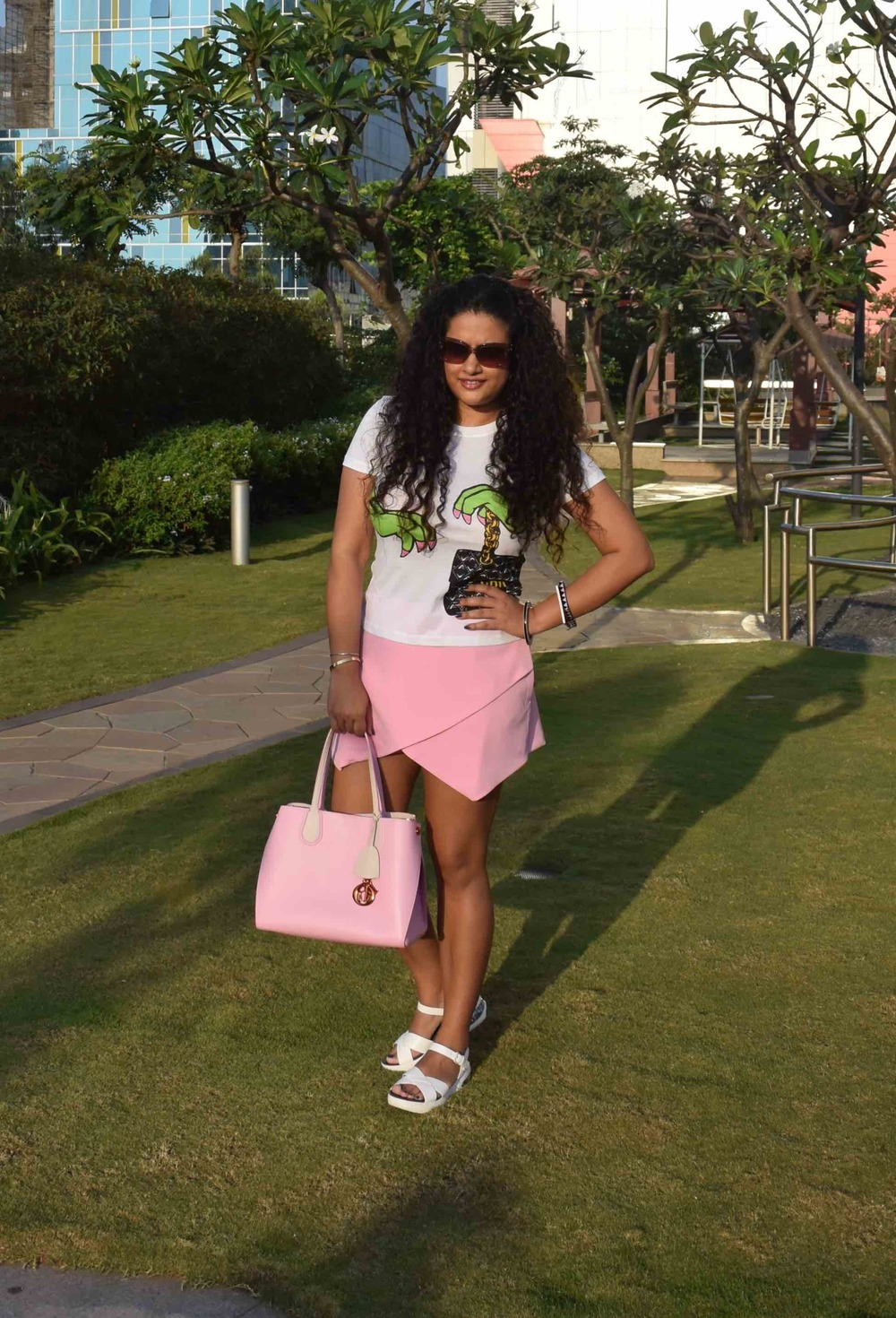 Skort - Asos, T-Shirt - Moschino, Bag - Dior, Sunglasses - Prada, Bangles - Furla, Sandals - Marc by Marc Jacobs