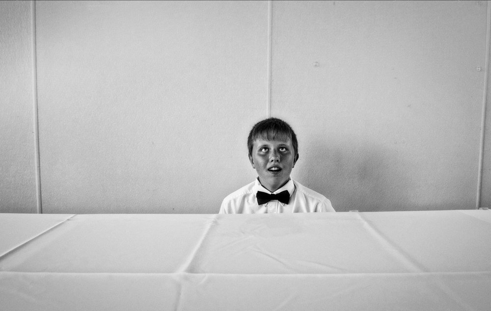 Boy At Empty Table