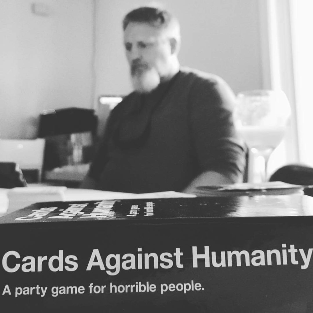 Candid. My conservative dad playing CAH on Thanksgiving. This was hysterical. Focus on the why while keeping the context in the photo. I know what my dad looks like. I don't need him in focus.