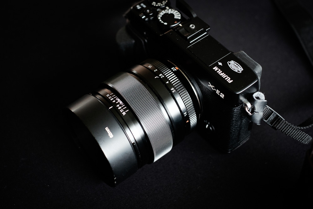 23mm F1.4 with metal hood attached.