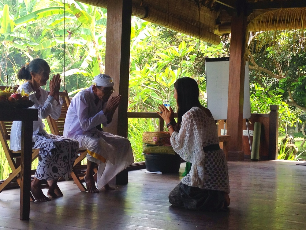 Receiving blessings during our closing ceremony with the Balinese priest and his wife.