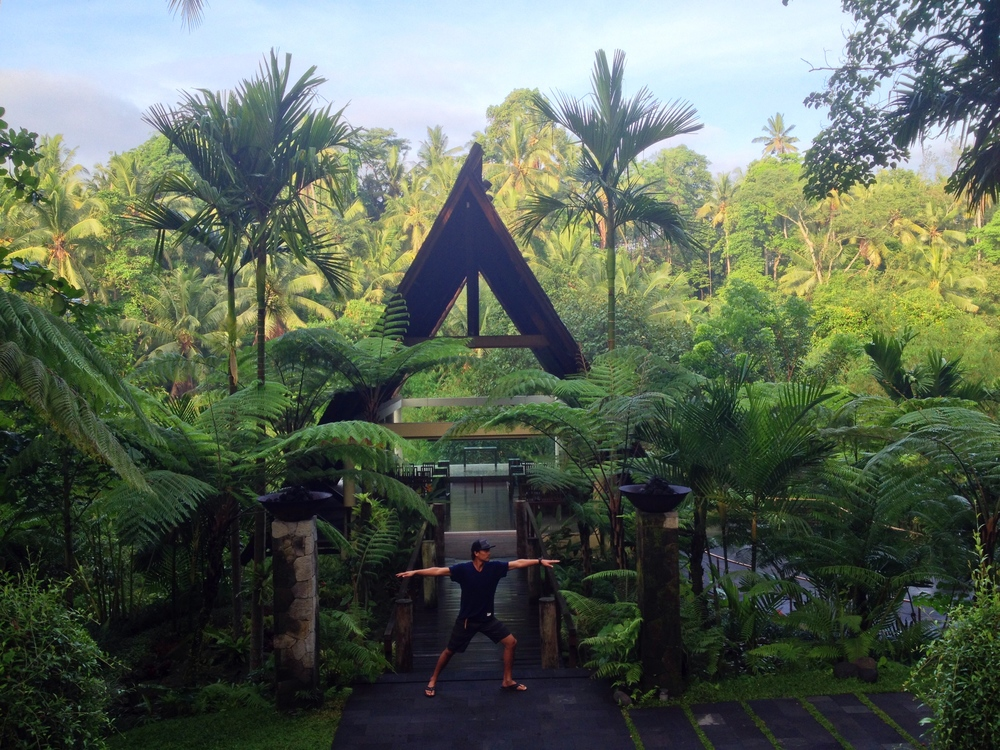 Jay, getting his Warrior 2 on, at the Komaneka at Tanggayuda in Ubud.