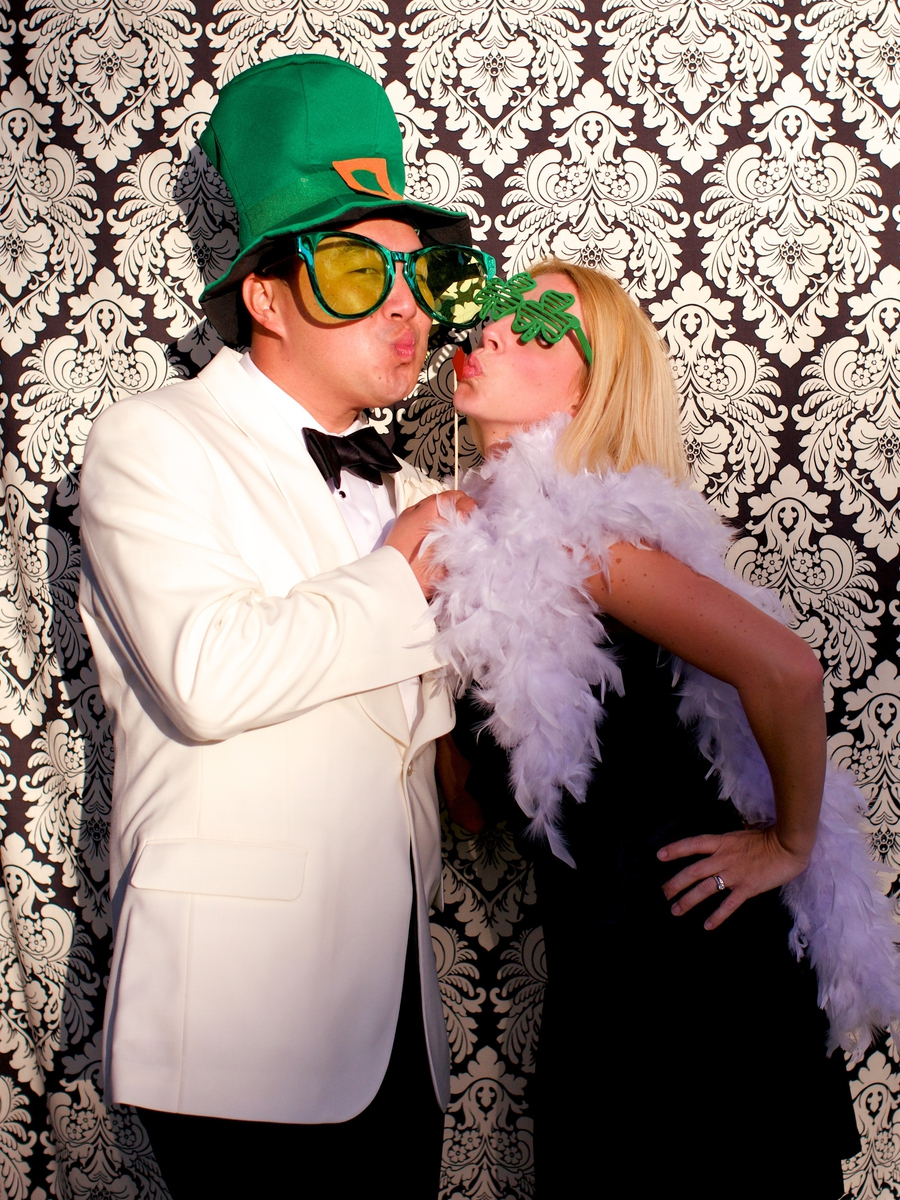 Custom photo booth complete with St. Patty's Day props