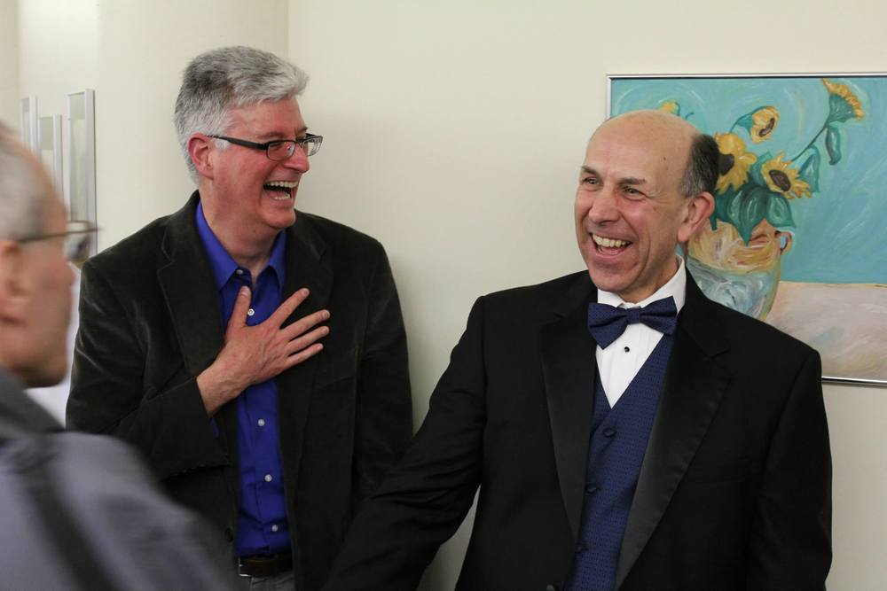 "Composer Will Wickham and poet Edward Dougherty share a joyous moment after the premier performance of their original work ""Where Sacred Waters Divide"""