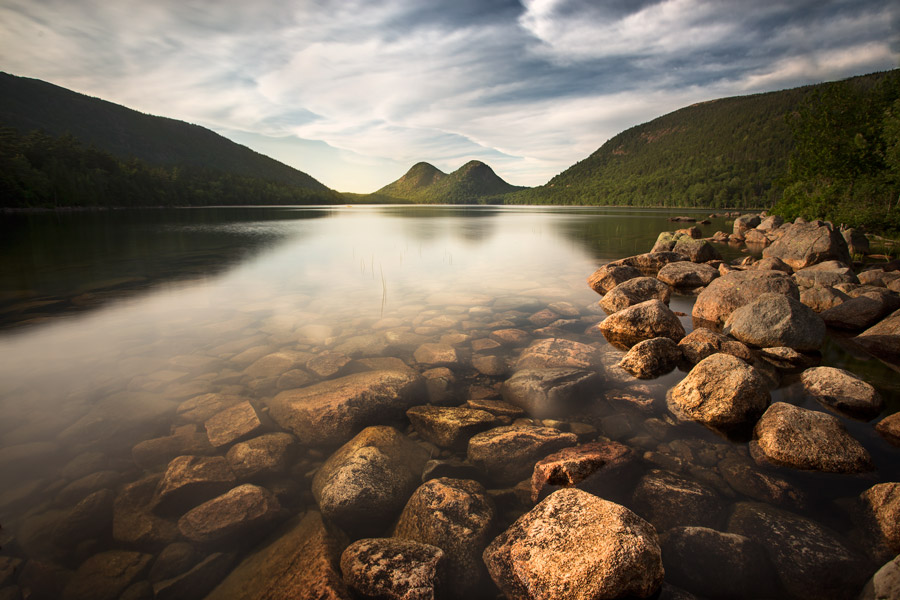 Jordan Pond in Acadia National park. The crystal clear water of Jordan Pond is overlooked by Bubble Rock Mountain, one of the trademark views of Acadia National Park.